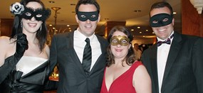4 masked people at the Challenge ball fundraising event