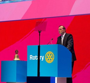 Rotary club convention man speaking on stage