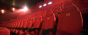 A row of red empty seats at cinema