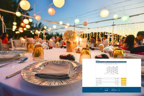 table set for fancy event with lanterns above