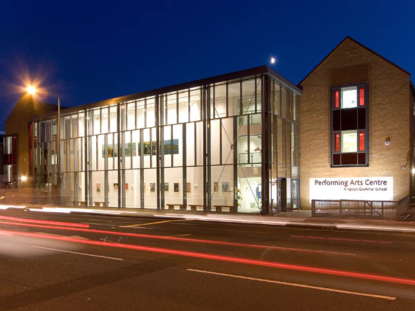 Kingston Grammar School Performing Arts Centre at night time from the outside